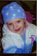 Blue-eyed pretty little girl in blue suit