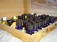 Several small bottles in a wooden box