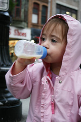 Little girl drinking milk from her bottle