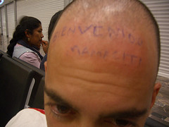 Man's bald head with some writings