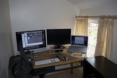 Three computers on a working table